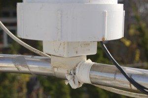 The PVC base cap screws on.