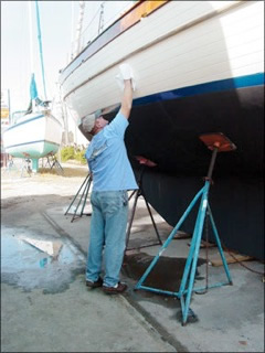 Man applying wax to hull