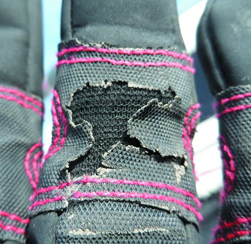 close up of Mustos glove wear